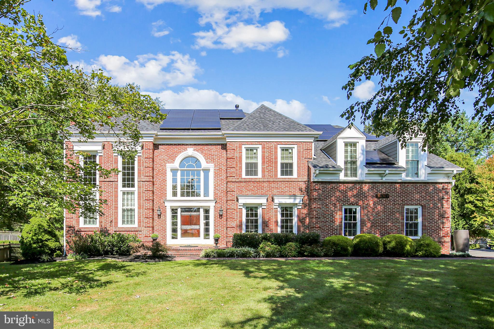 Welcome to this fantastic energy efficient 4 Bedroom 4.5 Bath contemporary Colonial located in the b