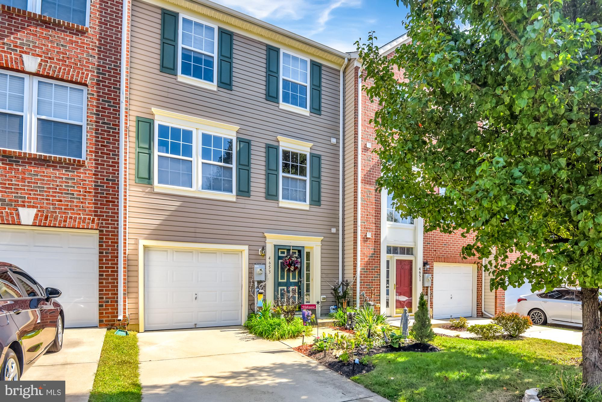 Welcome Home! Absolutely Gorgeous Home offering 3 Finished Levels of Perfection.  No grass cutting L