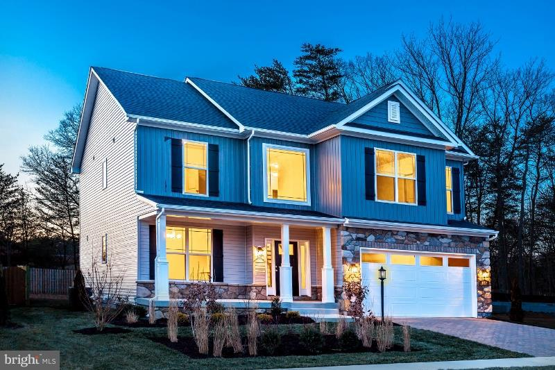 Ameri-Star Homes, a premier home builder, presents The Taft Model, a Craftsman style 4-bedroom home