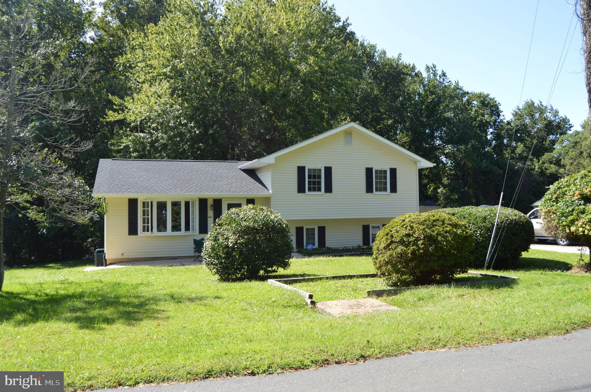 WOW don't miss this great split four level home less than a quarter mile from  the Naval Golf Course