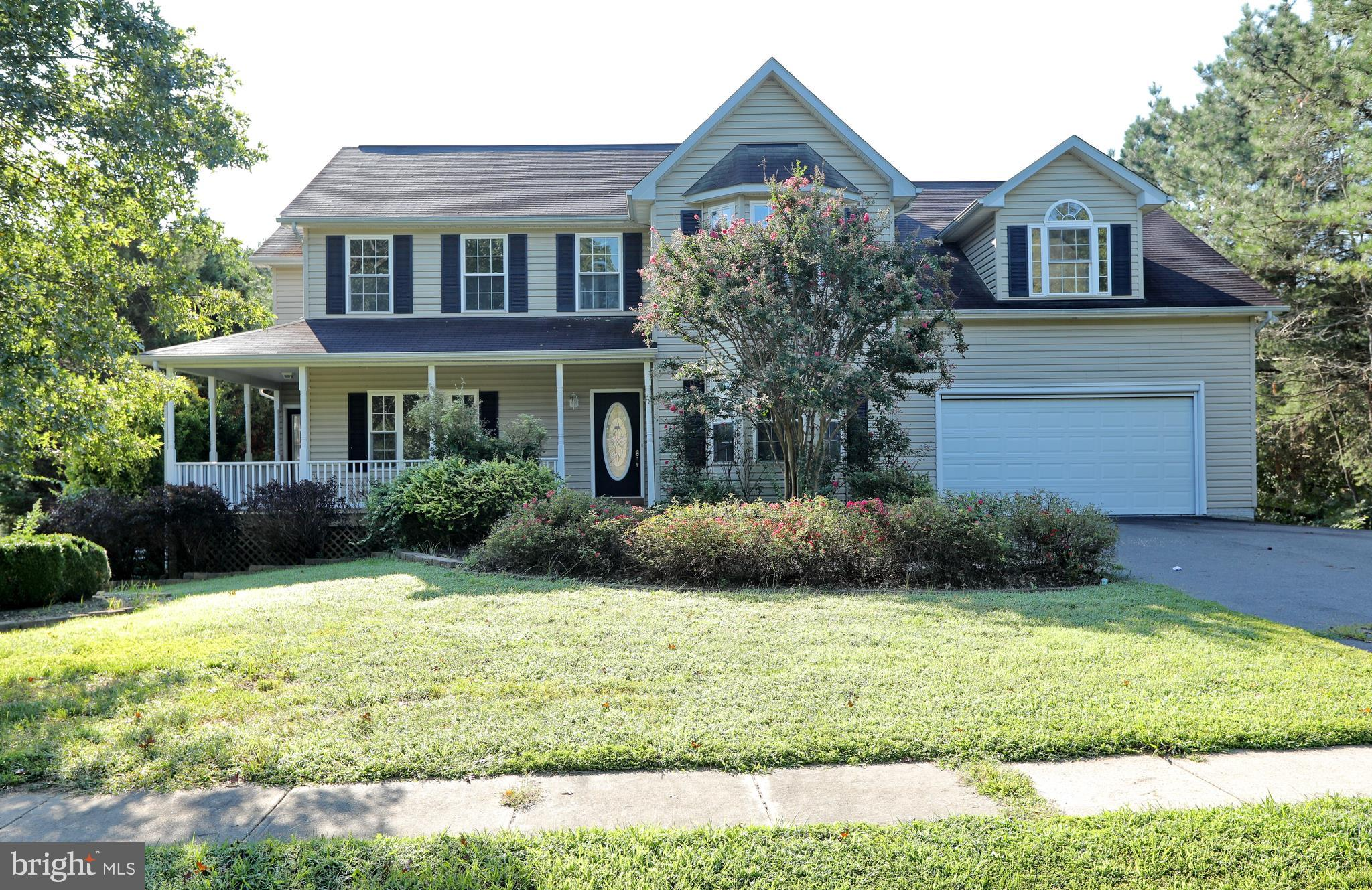 Classic, lovely, traditional...this colonial promises it all!  This special home, a traditional, cen