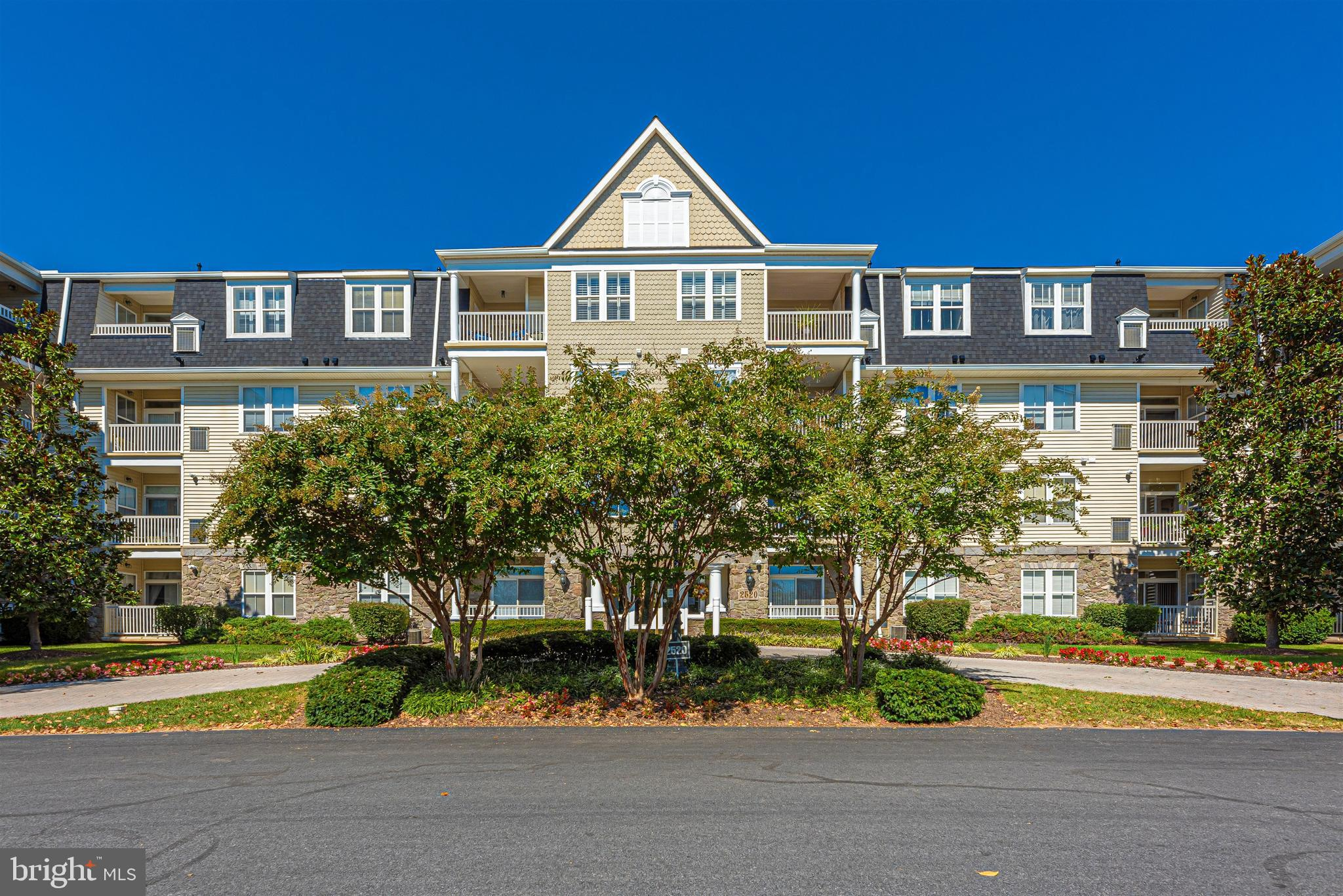 Beautiful 1st floor condo with 2  GARAGE PARKING SPACES!  Oak floors in the living and dining rooms
