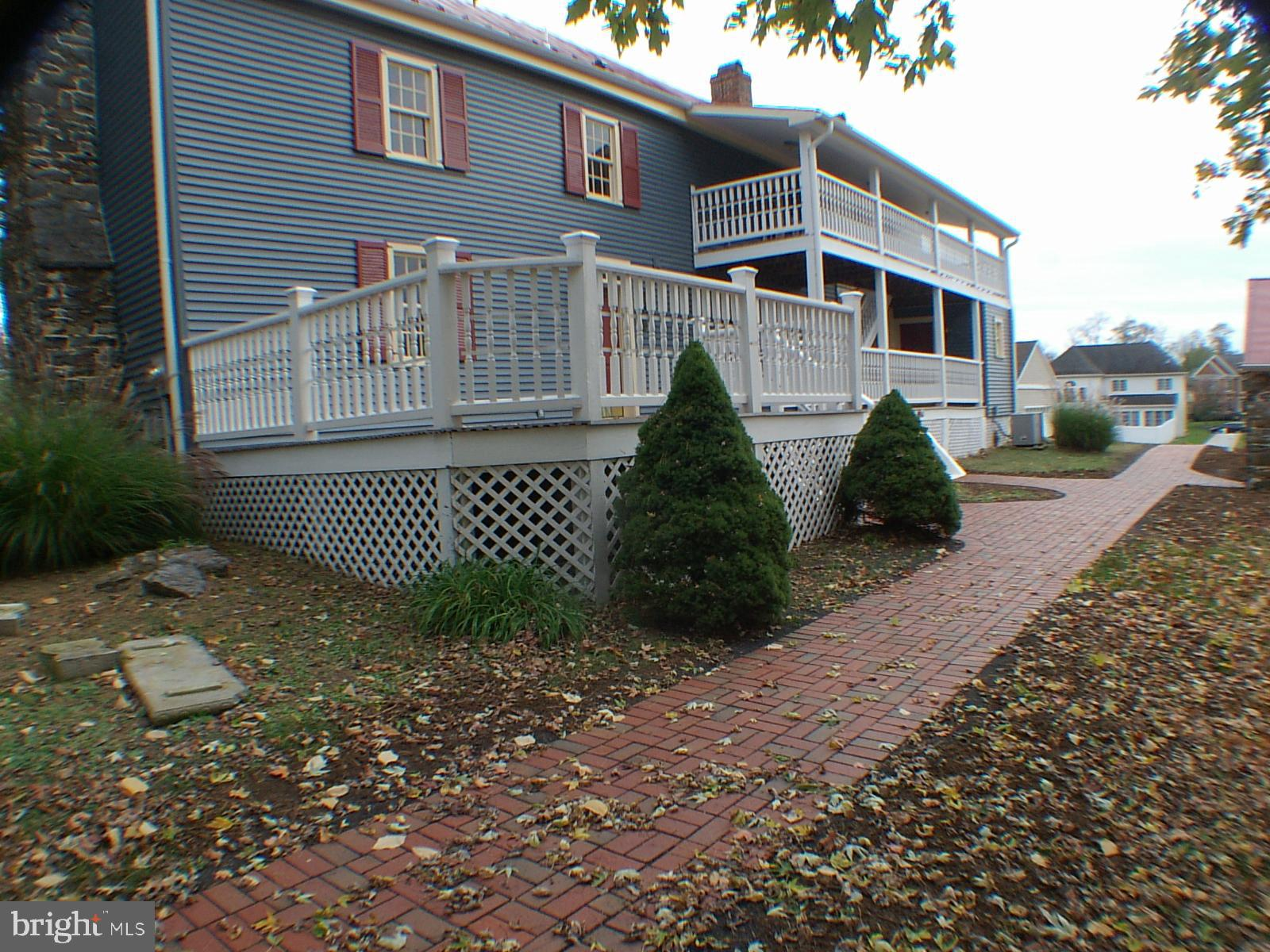 The built in 1790 Historic Registered Homespun Carriage and Tea House on 1 cleared acre.  Meticulous