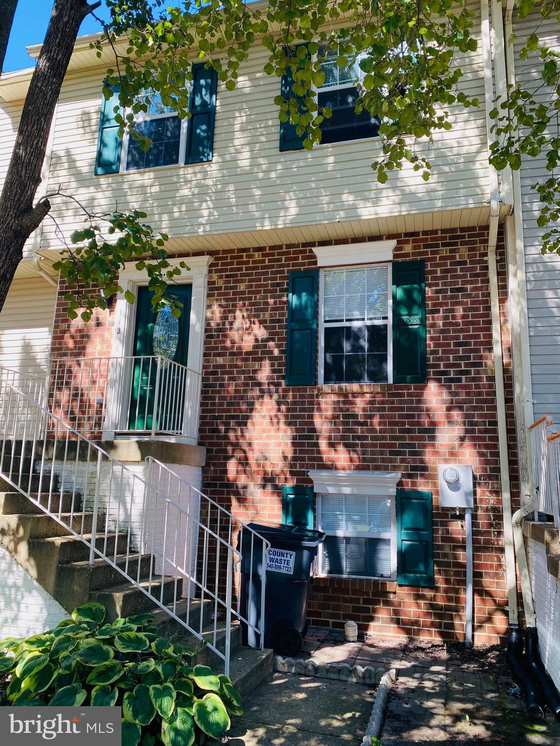 Three level townhouse brick front is ready for your family! Conveniently located, close to shopping