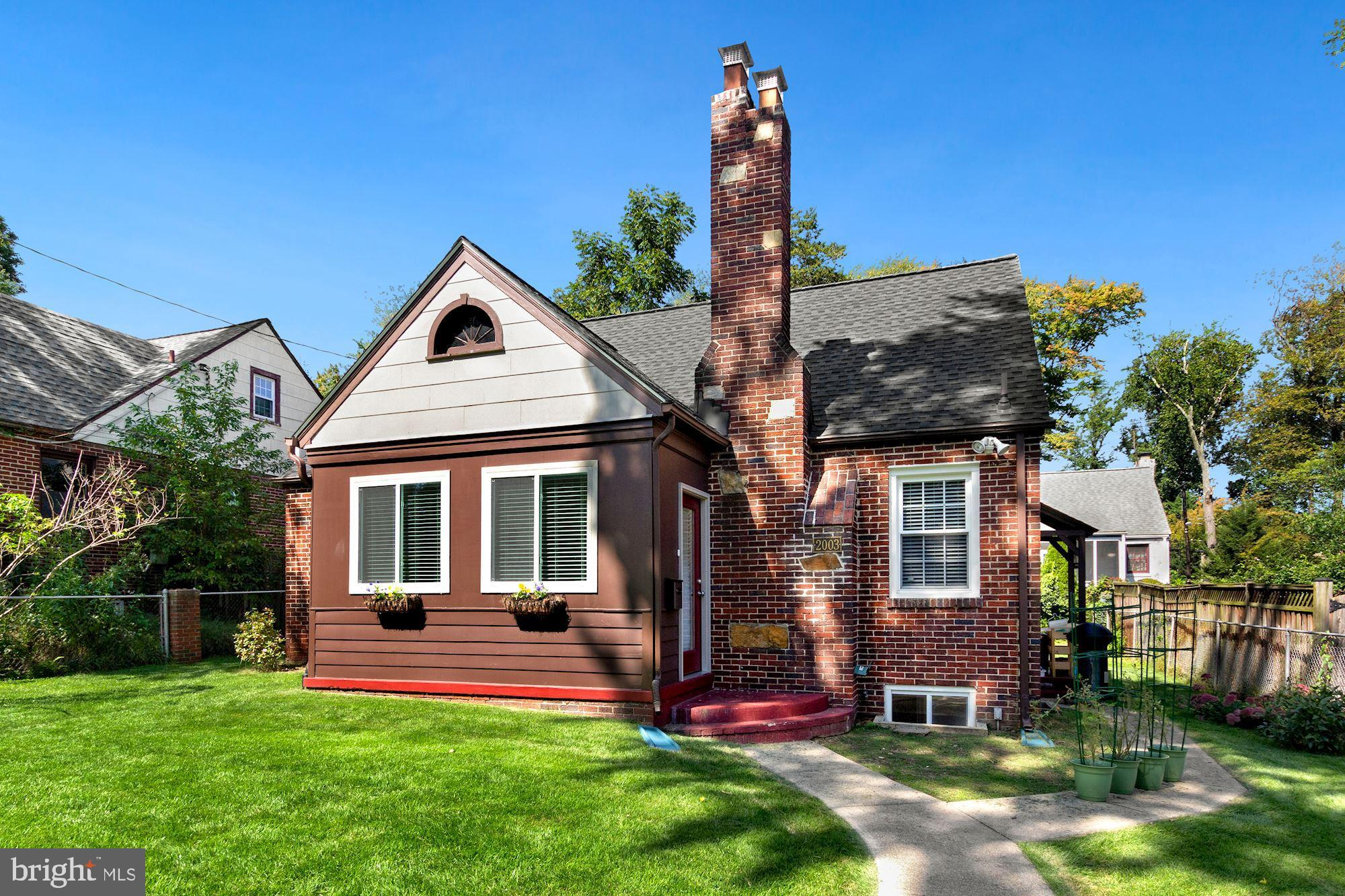 Inviting brick Cape Cod style house on a picturesque lot in the wonderful Woodside Knolls neighborho
