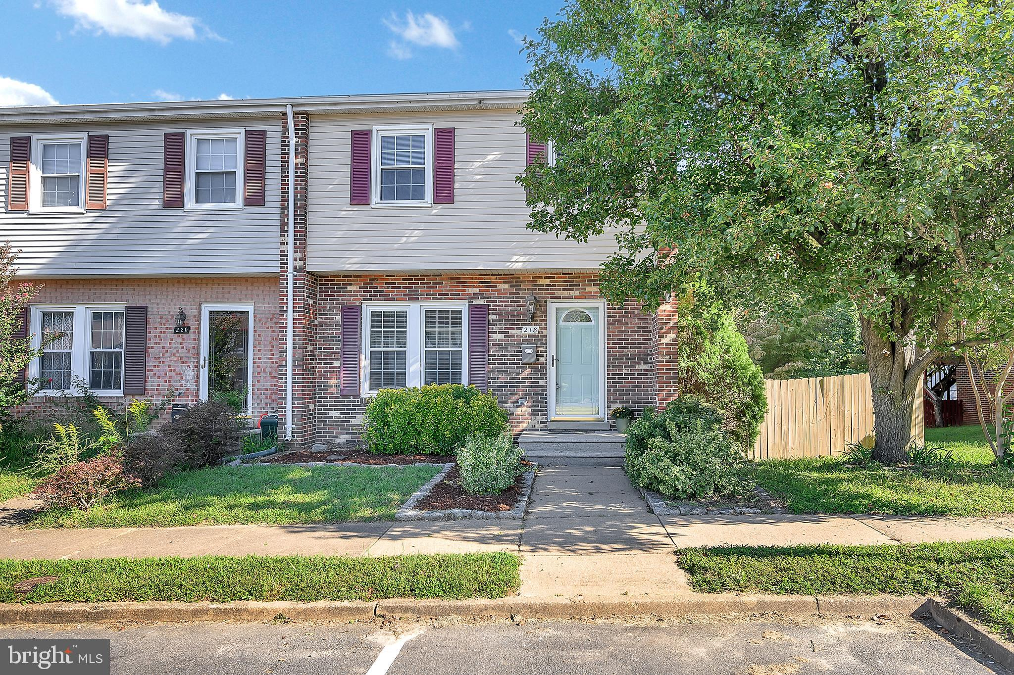 Lovely 3 Bedroom End Unit Townhome with 2 Full Bathrooms and 2 Half Bathrooms.  Updated Kitchen with