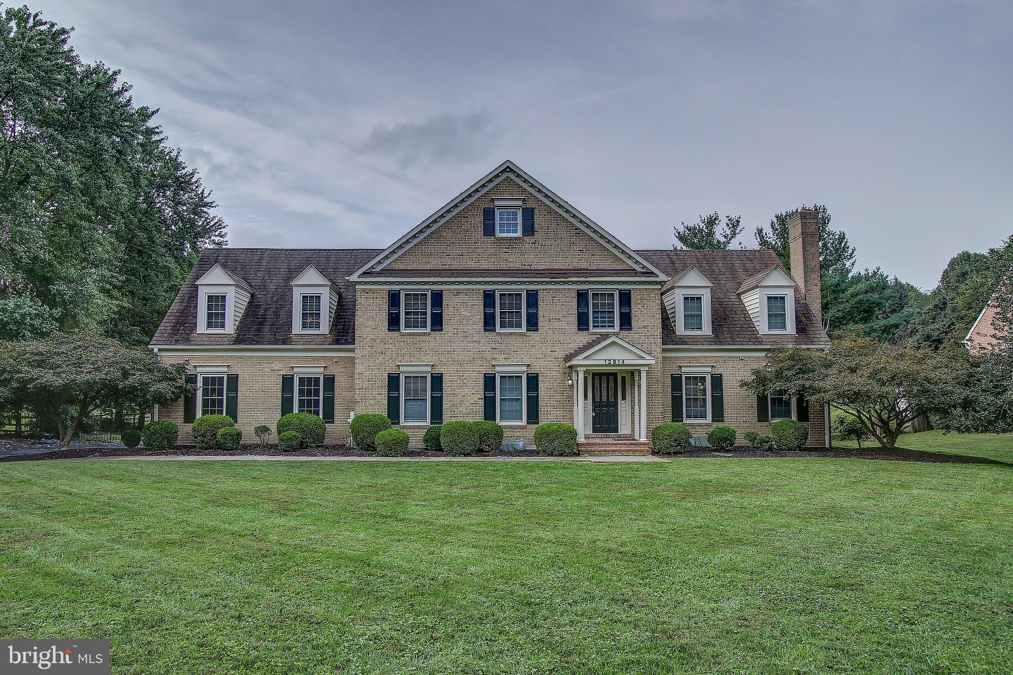 This fully renovated home sits on over 2 acres and offers 6 bedrooms / 5 full baths, including  a ma