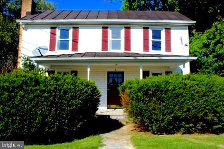 Two great homes - one low price! Move-in ready - live in one and rent the other or use second home f