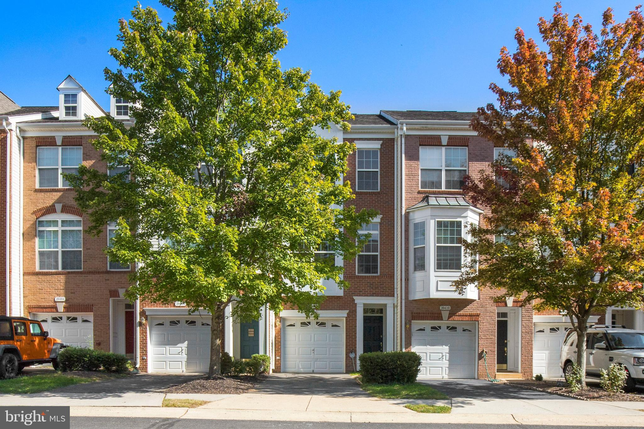 Magnificent townhome with garage in the desirable Belmont neighborhood of Ashburn and only minutes f
