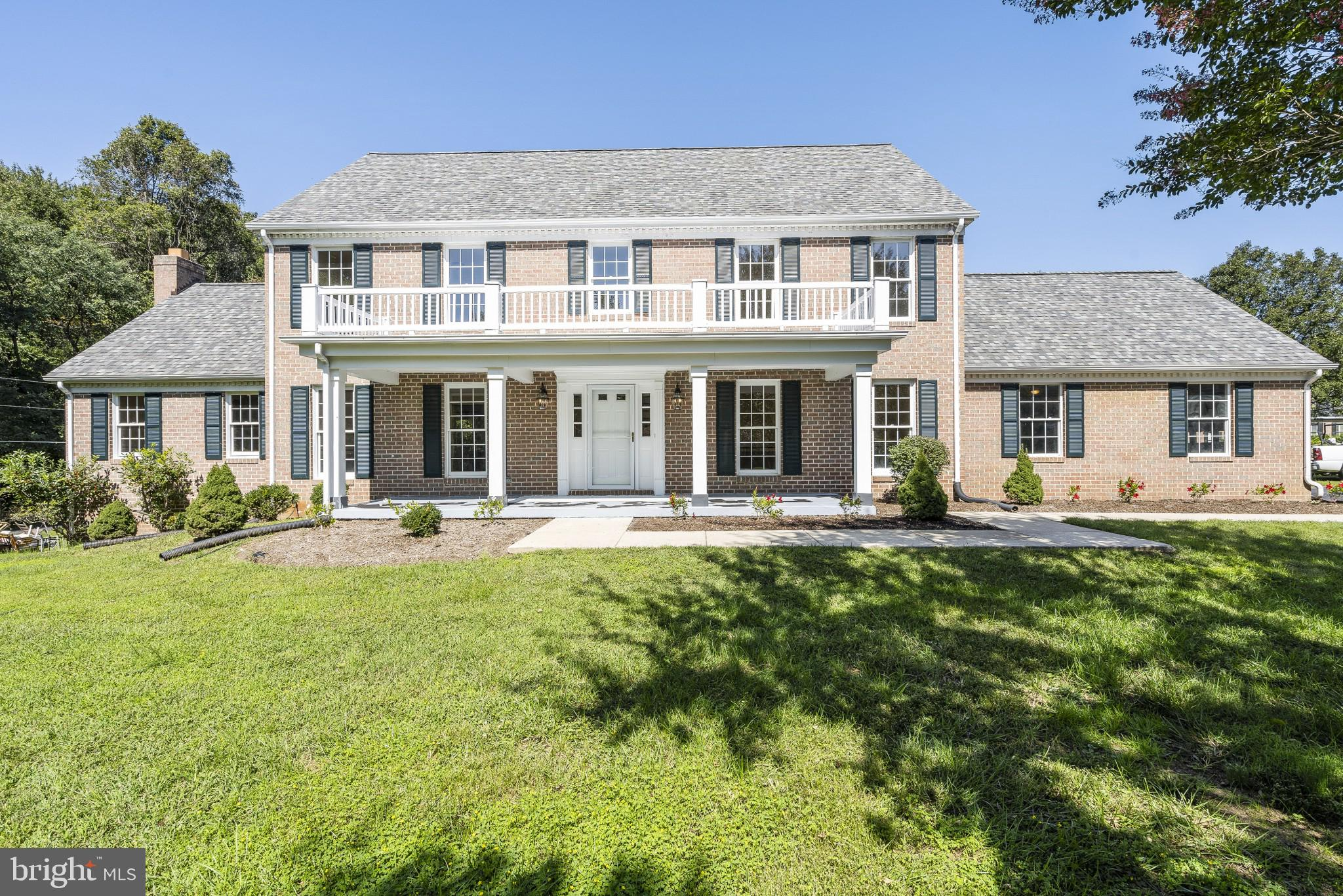 Just what you have been searching for! Huge all brick custom colonial on a one acre level lot that c