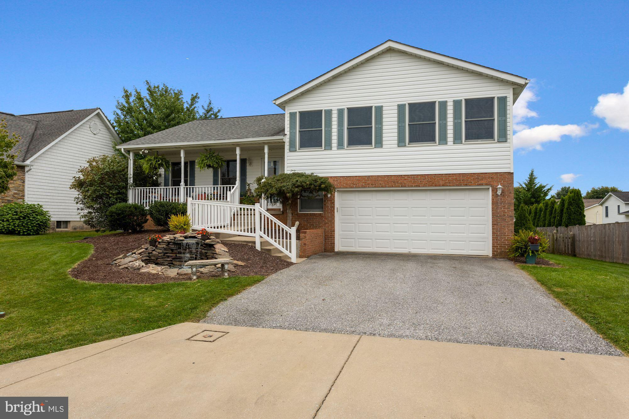 Loved and cared for, this home has it all and it starts at the front door! An inviting covered front