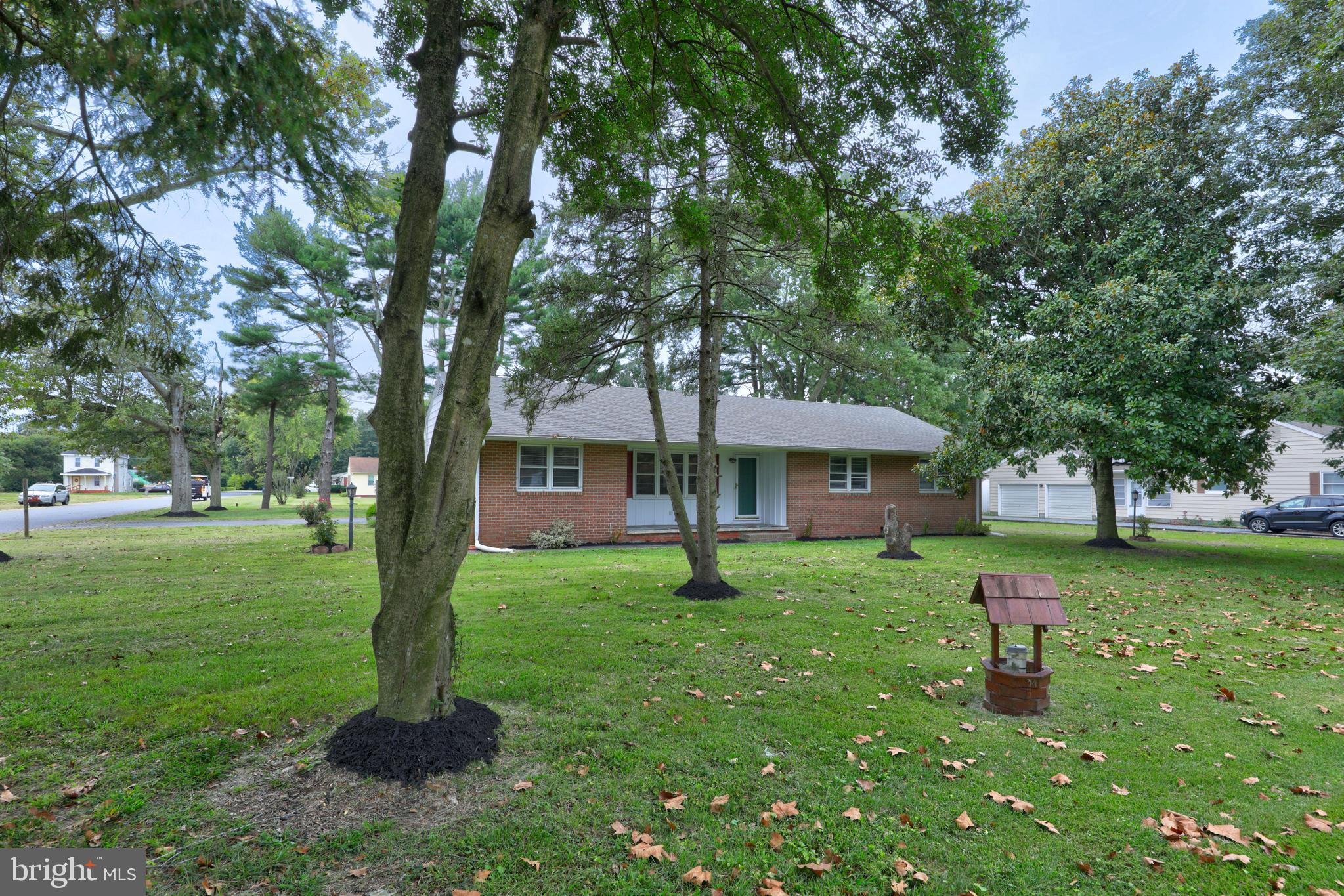 This beautiful brick home is conveniently located  on a large corner lot in the town on Delmar MD.