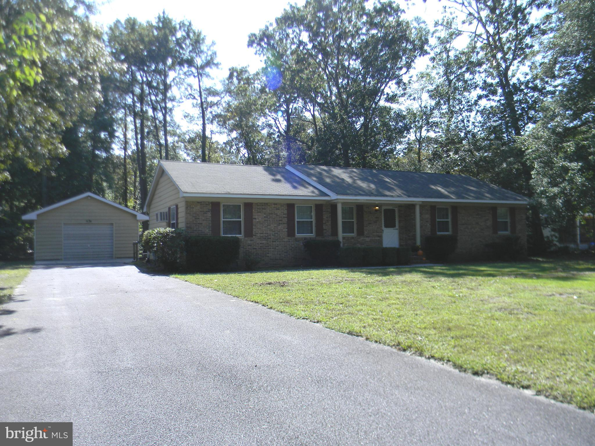 Welcome Home!! One Level Living on a private and partially wooded  .46Acre lot,  located on an aweso