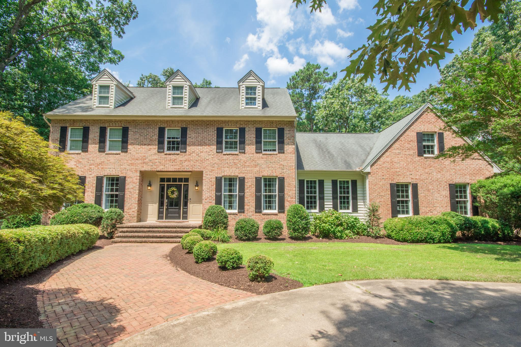 Beautiful brick front Colonial located on a cul de sac, large open kitchen with center island, grani