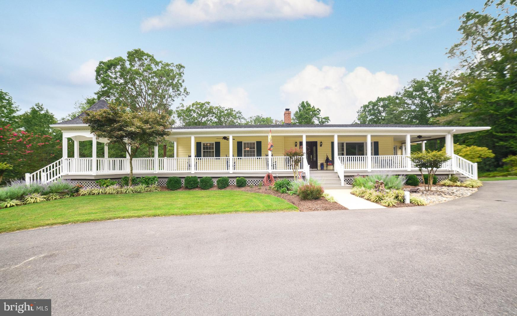 This impeccably maintained rambler sits on a secluded 2 acre lot.  Lush landscaping and an expansive