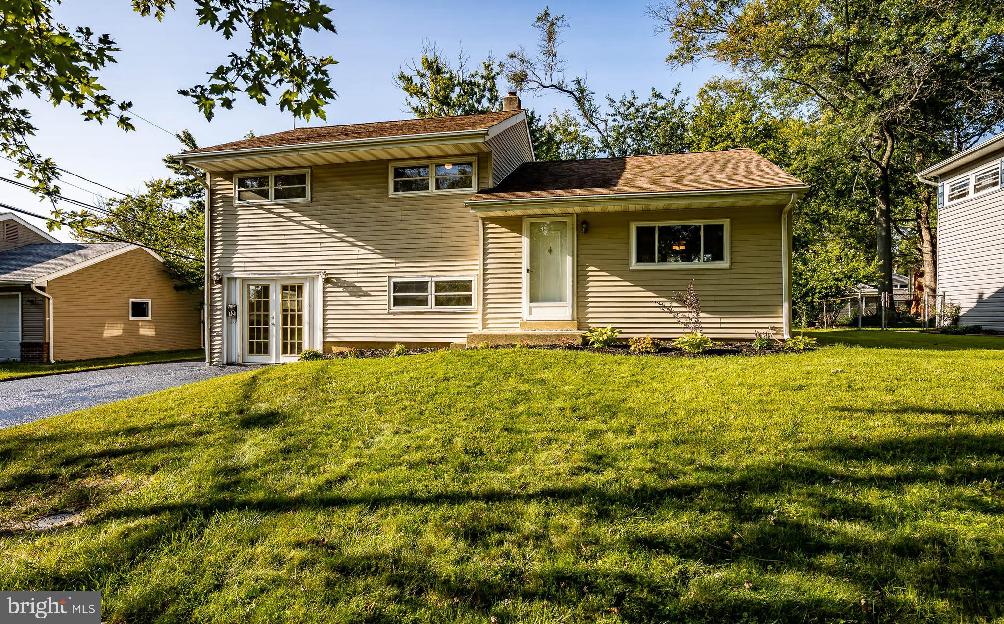 WOW,  North Wilmington for under $250K!! Come see this split level home in Ashbourne Hills situated