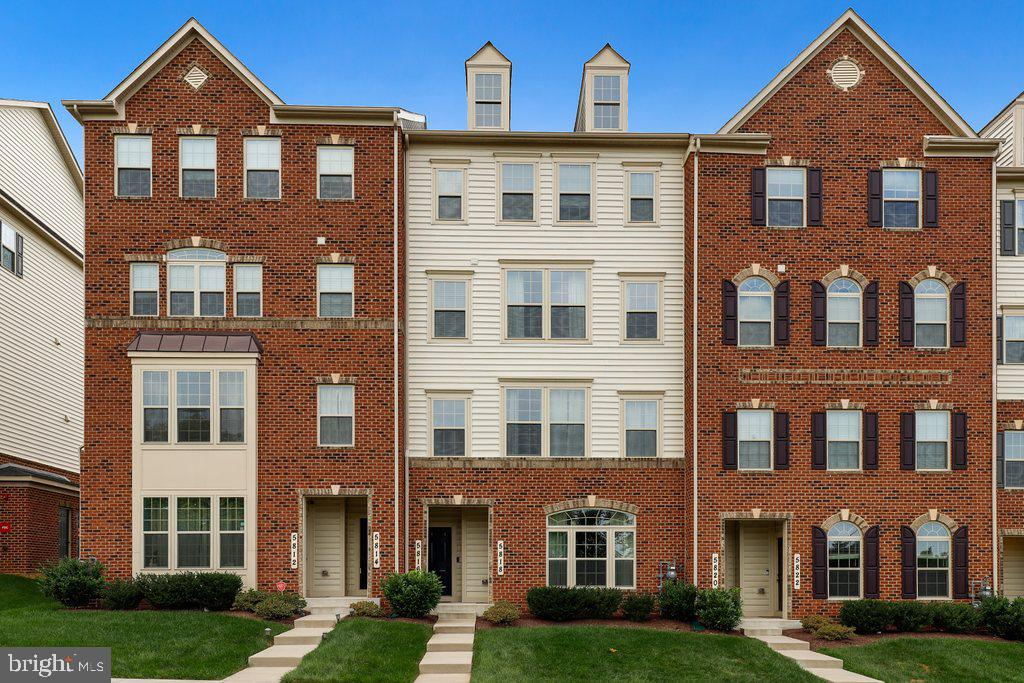 A rare opportunity to buy a better-than-brand-new large brick townhome in Oakdale Village! This gorg