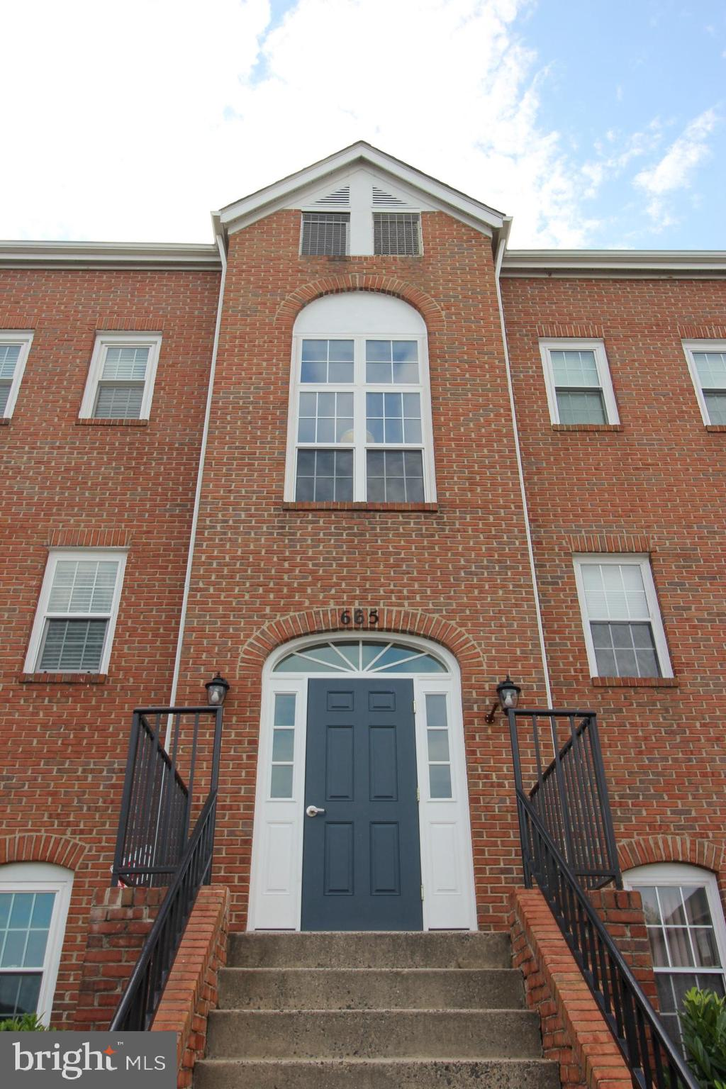 Amazing light filled Condo!  Features include and open floor plan,  hard surface floors throughout m