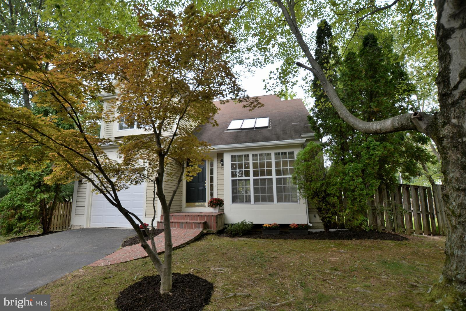 Lovely home with fenced back yard.  Bright & cheerful Living Room with skylights & a ceiling fan.  B
