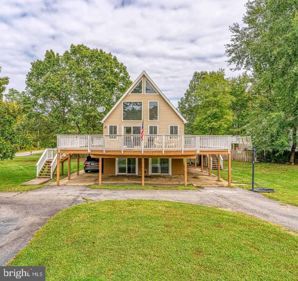This beautiful A-frame style home is unique to the Wicomico Shores neighborhood. Featuring high ceil