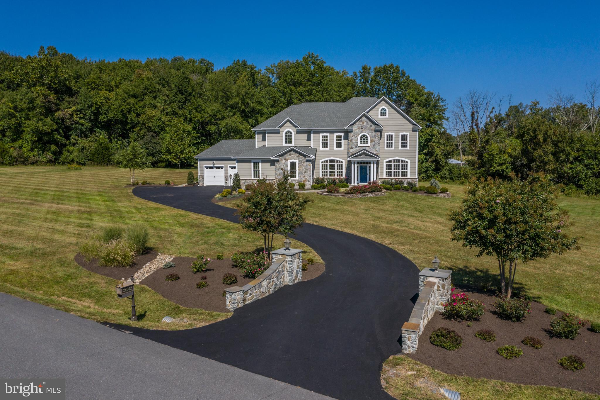 Gorgeous estate home sited on just over 4 acres, nestled in the stunning Loudoun County Countryside,