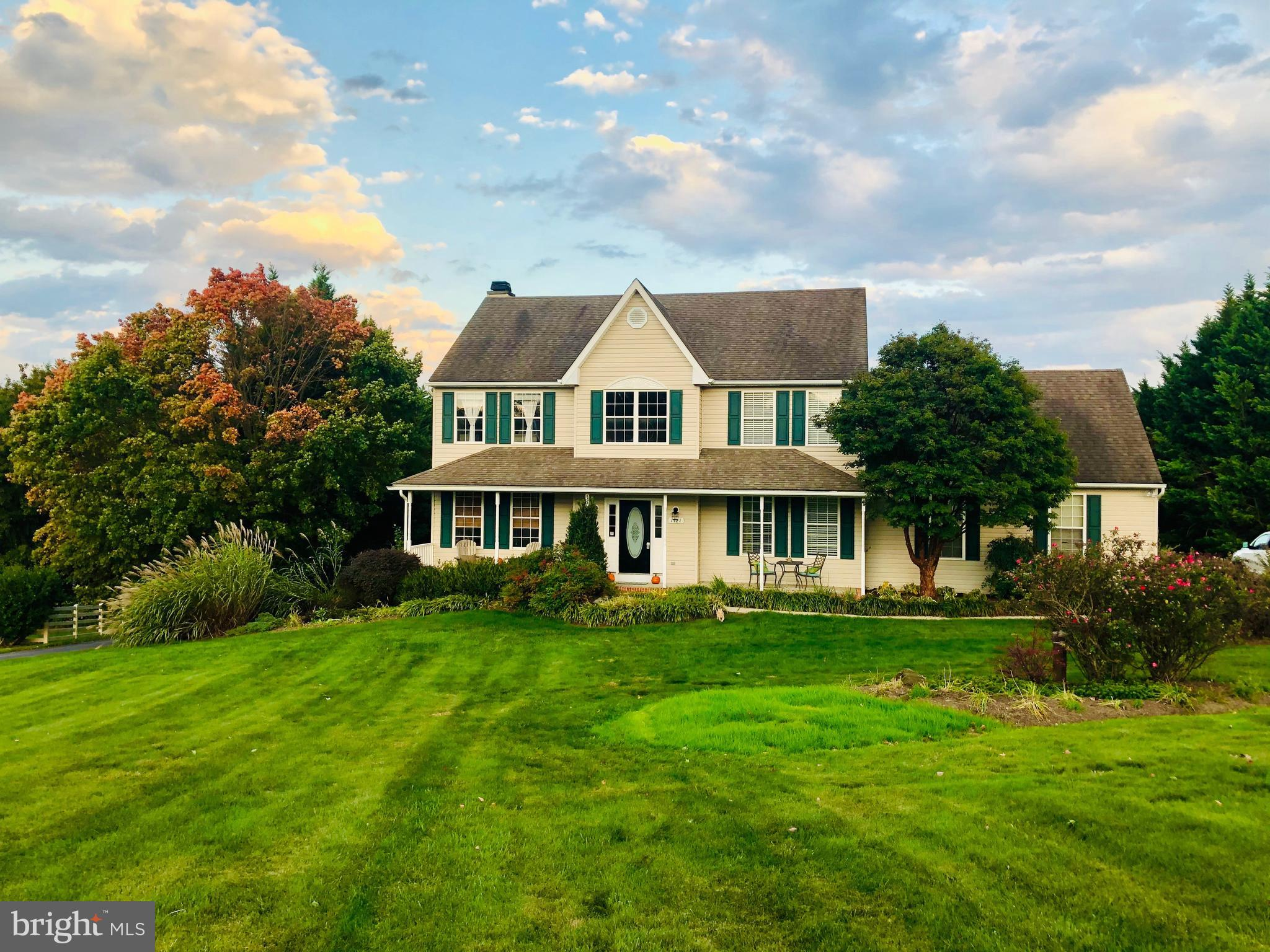 Gorgeous  Colonial on a  Beautiful  2 acre lot  with attached 2  car garage on a  cul de sac.    Fea