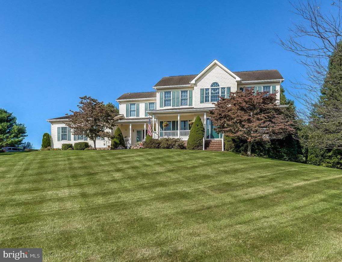 Excellent 3.03 acre lot with a  custom two story colonial.  This home offers an open floor plan with