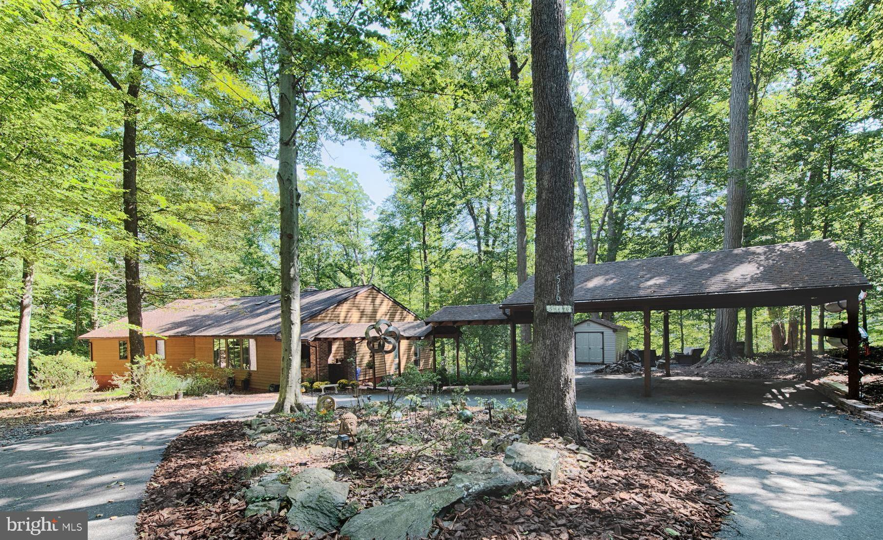 Gorgeous contemporary home with Cedar siding nestled in the woods on private lot sitting up high wit