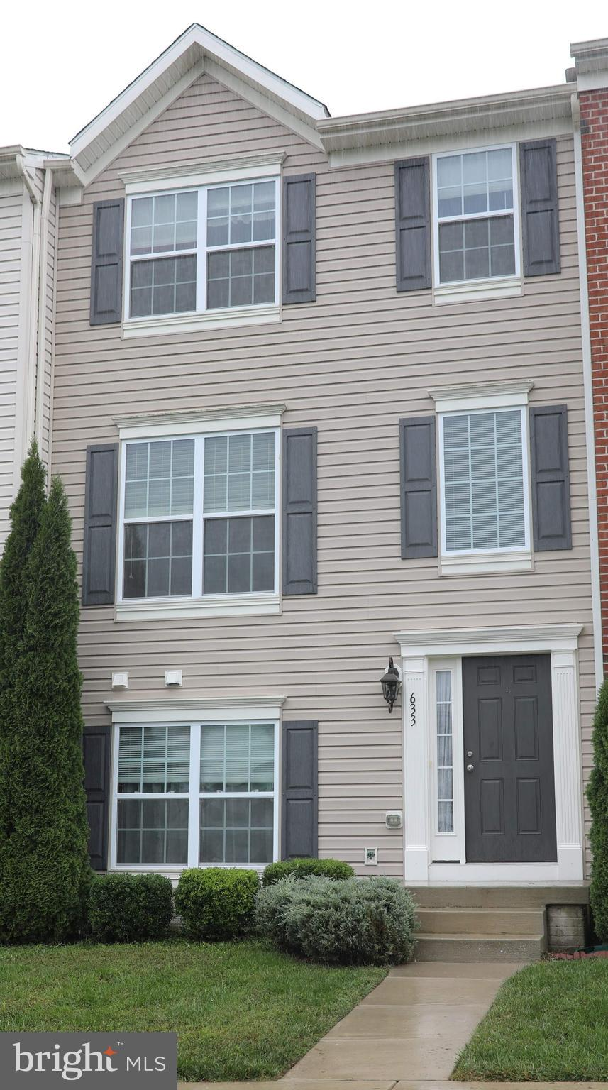 Three (possibly four) bedroom townhouse in like new condition.   Features include:  Large rooms, gra