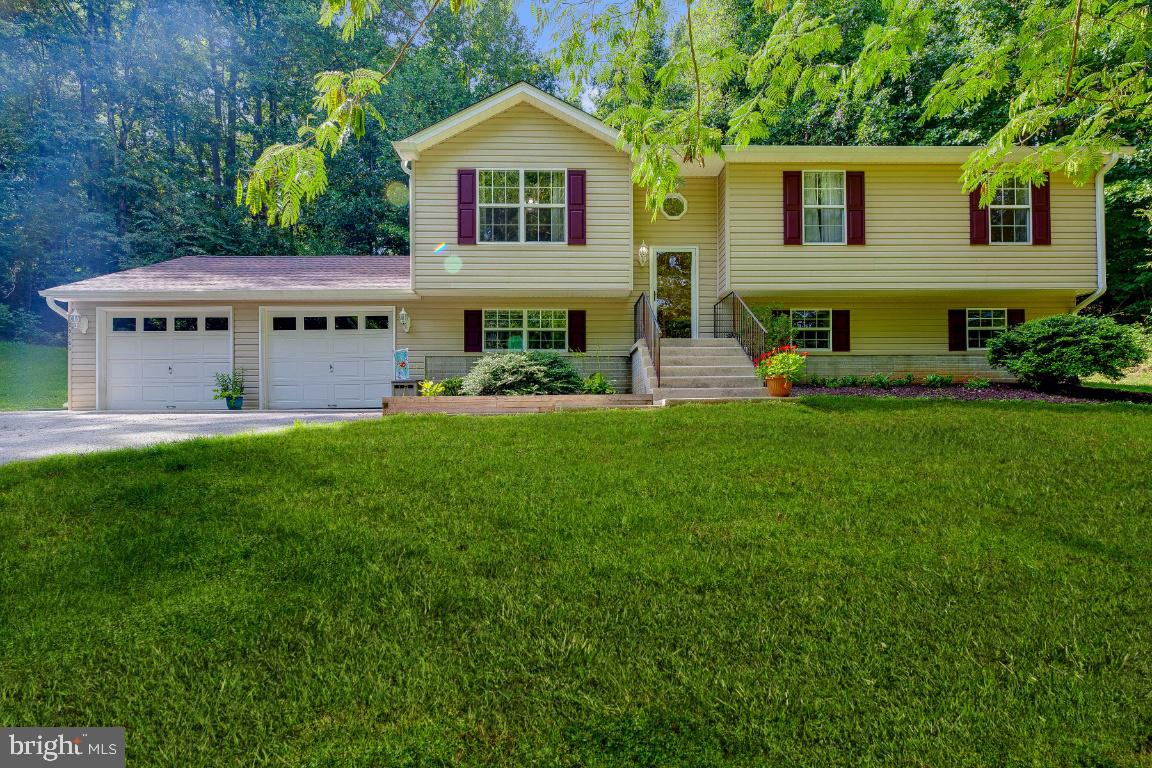 Don't miss this one!  2+ PRIVATE acres of the beautiful great outdoors surround this updated and wel