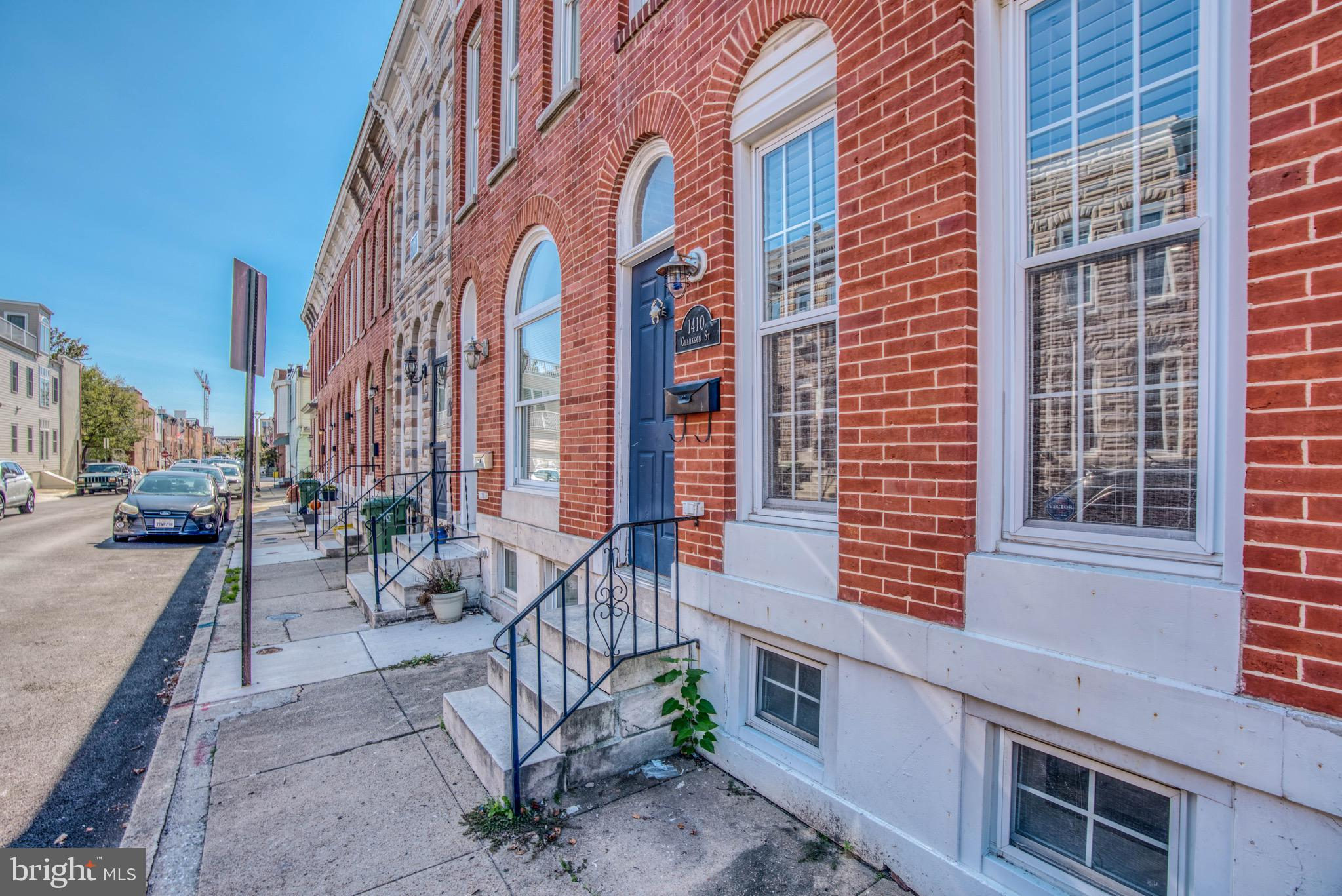 Great three level, three bedroom, two full bath row home right near the heart of Federal Hill on the 1400 block of Clarkson Street.  House is freshly painted and stylishly appointed.  Basement is fully finished with a bedroom and bonus room.  Ceilings are high and house boasts exposed brick and an open floor plan.  House has plenty of storage areas as all extra space has been turned into closets and nooks. There is a deck off the second floor back bedroom that sits over the bricked, fenced  in patio.  A must see!