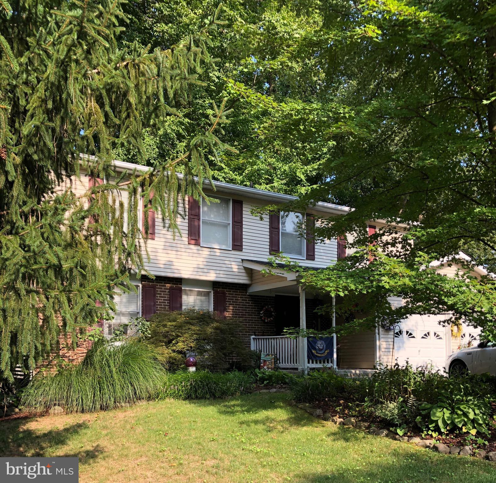 Welcome home!  This charming colonial sits on a quiet cul-de-sac with mature trees and beautiful gar