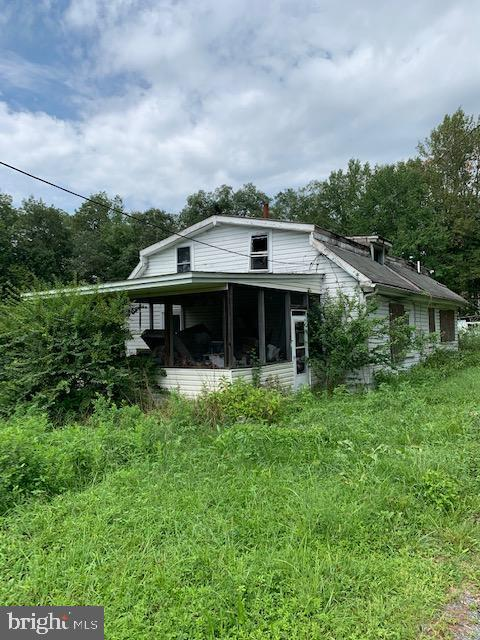 GREAT INVESTMENT OPPORTUNITY/LOT FOR A NEW BUILD! ALMOST 3 ACRES NEAR DOWNTOWN NORTH EAST! STRUCTURE
