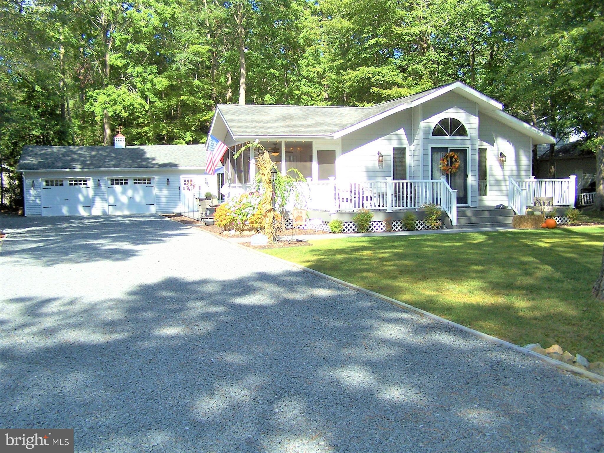 This charming home is located on an over-sized lot in the sought after community of Sherwood Forest
