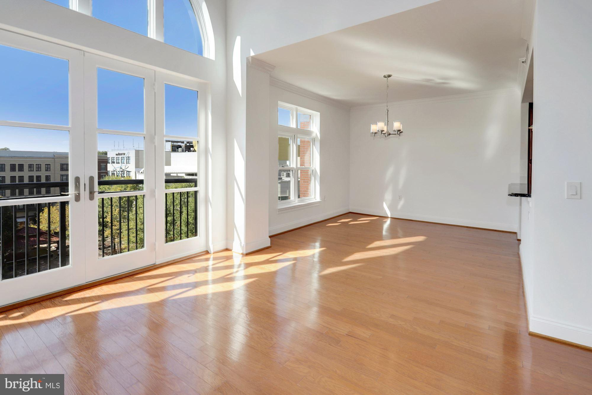 MODERN 2-level penthouse condominium in the Palladin with a bright, open floor plan, high ceilings,