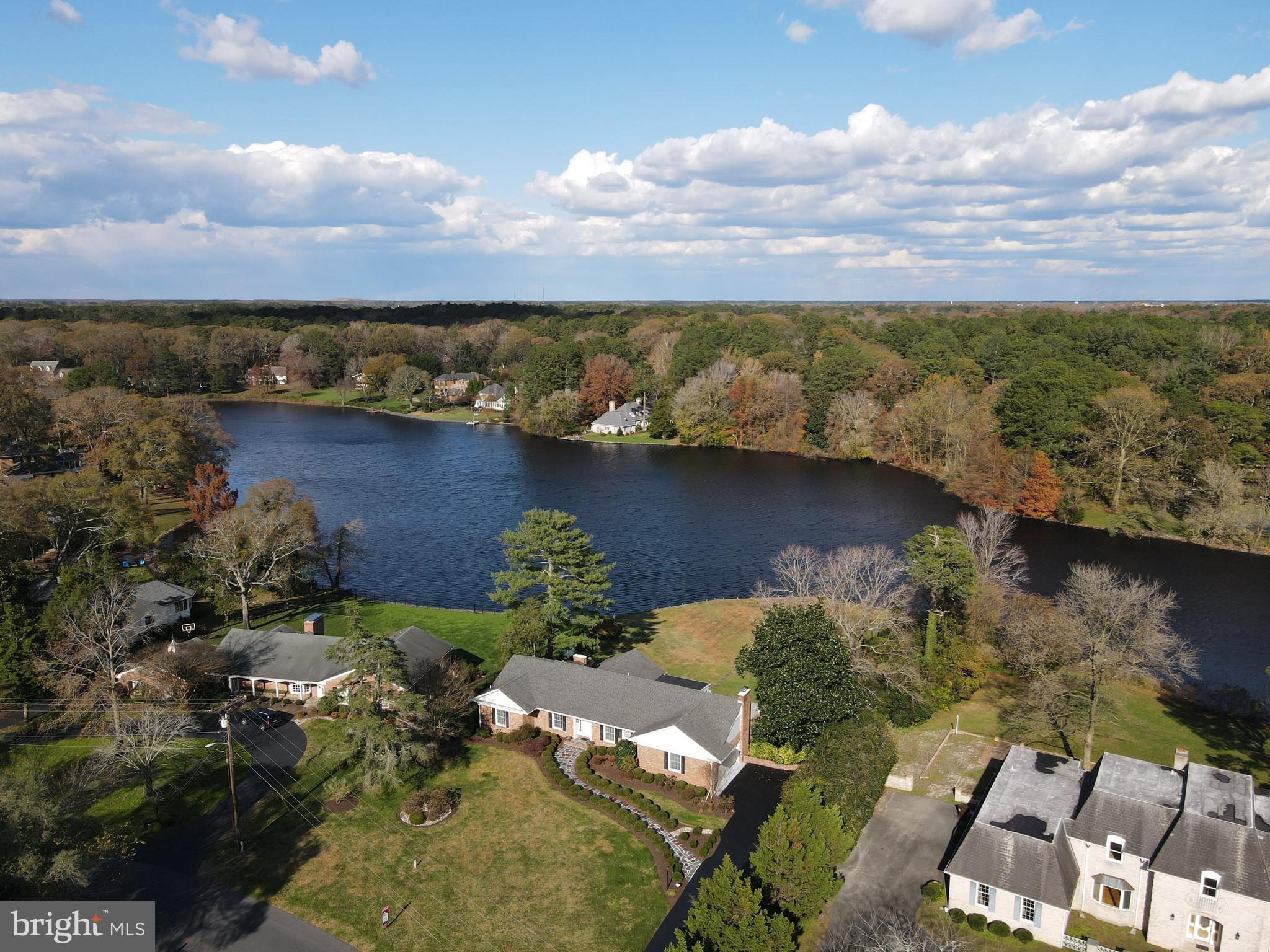 Stunning inside and out!  Enjoy peaceful, waterfront living at its best in this beautiful brick home