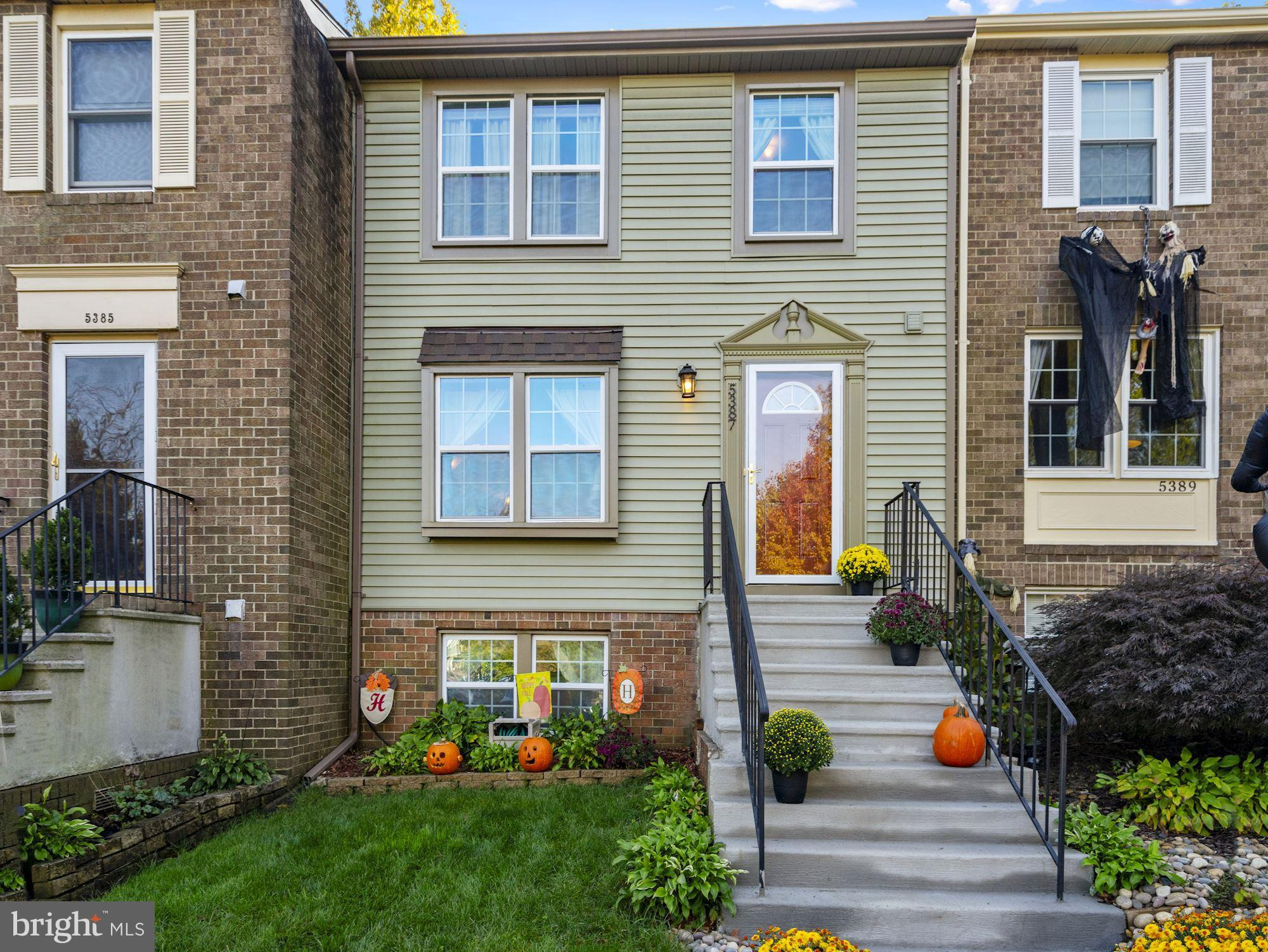Ideal location and Ideal home!   This wonderful townhome is truly move-in ready.   It was completely