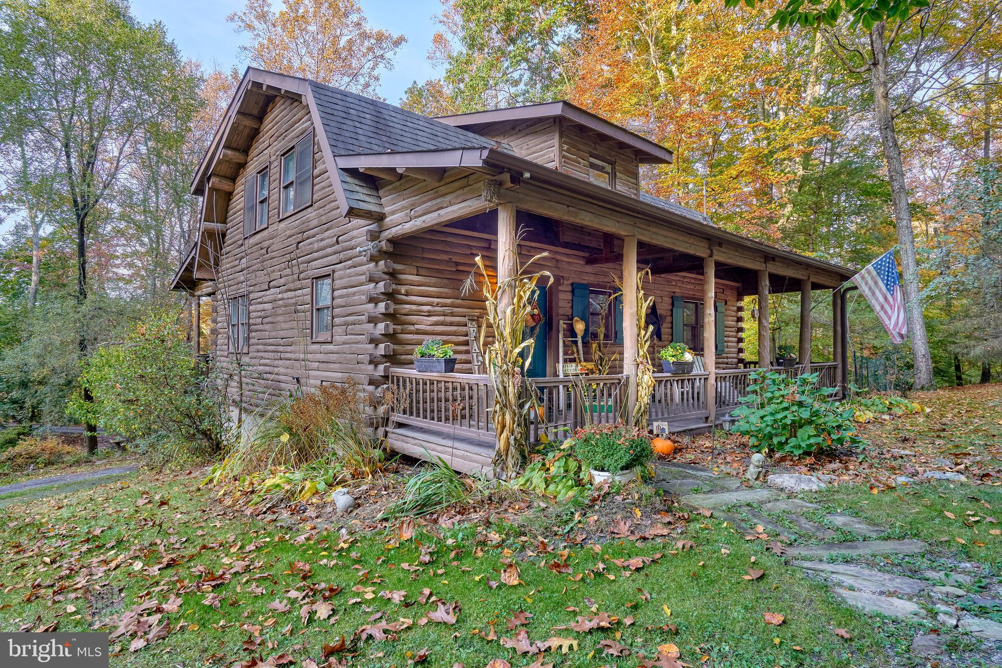 Gorgeous home in Bear Mountain on over 2 acres of pristine property!!! Log clad, frame constructed h