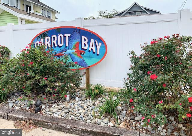 "EXCELLENT PRICE!   Parrot Bay is like being in Margaritaville!  ""With a shaker of salt"".   This nearly 500 sf one bedroom one bath 2nd floor condo has a shared balcony overlooking the pool.   Excellent, fun downtown location so...walk everywhere! Ceramic tile floors through out.  Being sold furnished."