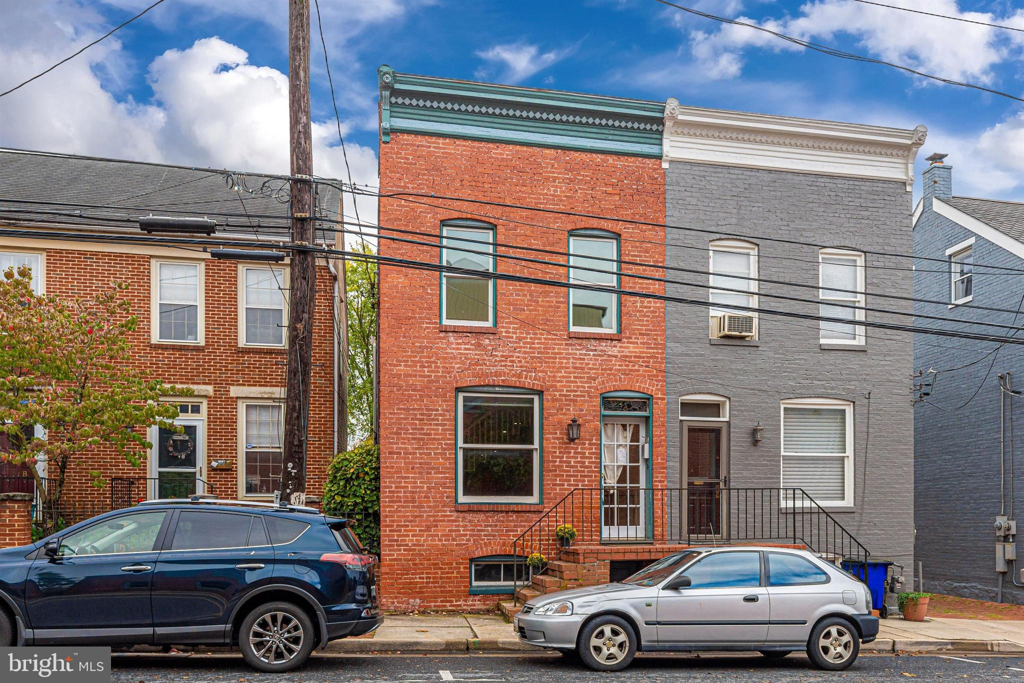 Welcome to this charming brick townhome in vibrant downtown Frederick! Having parking is gold and th