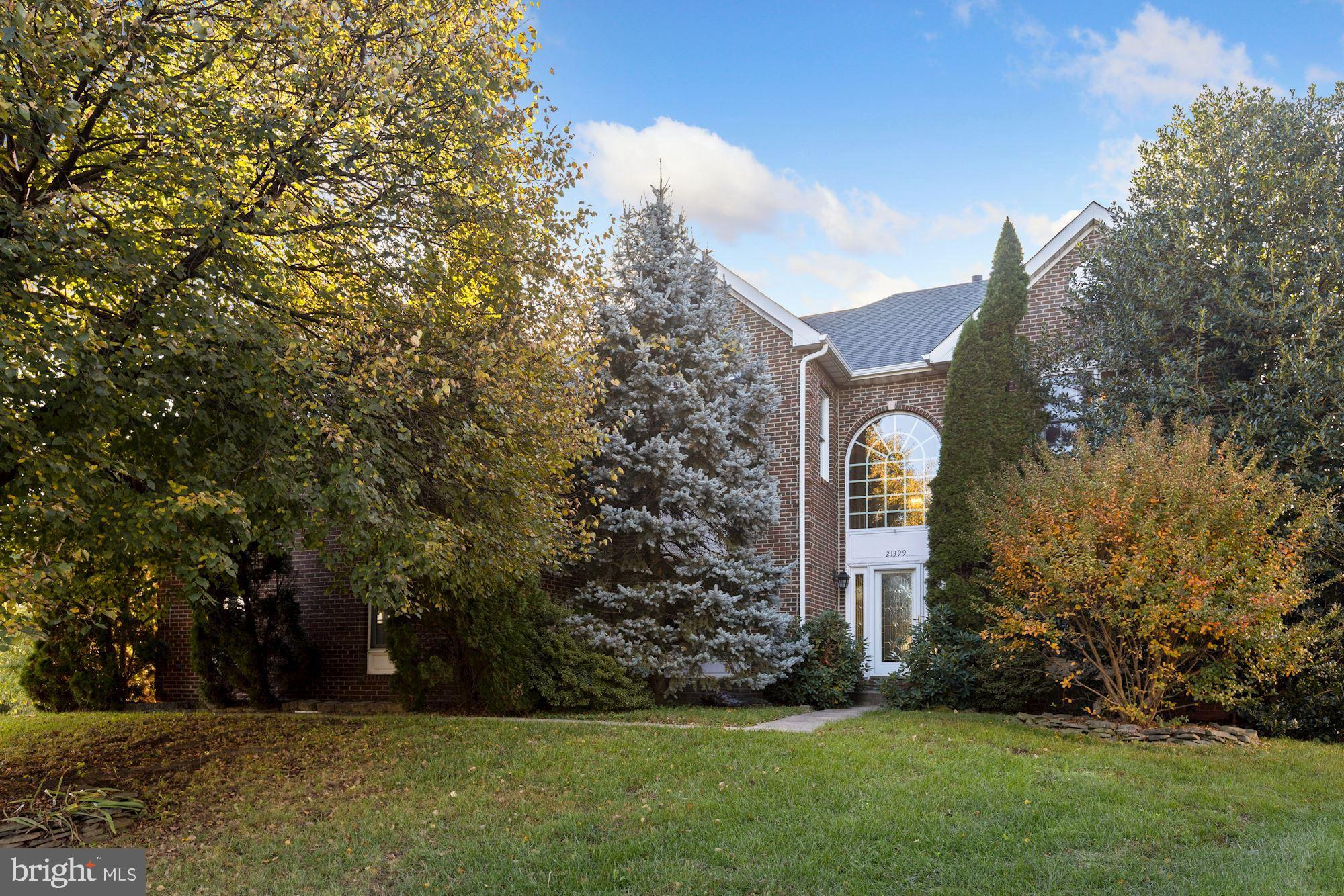 Brick front colonial on the end of a cul-de-sac with large fenced in yard.  Three finished levels, 5