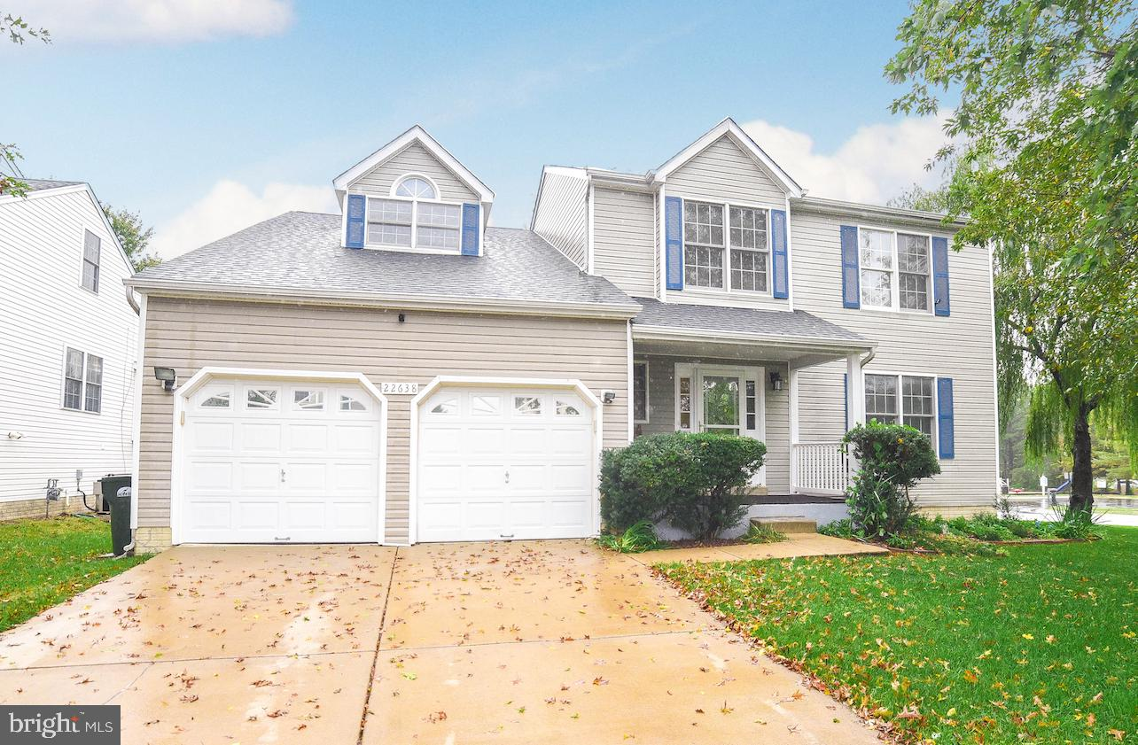 Attractive, meticulously maintained colonial situated  on a corner lot. Formal living room, dining r