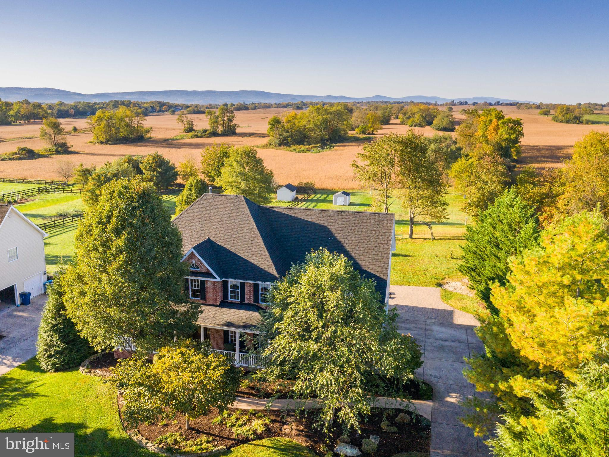 Amazing views from the huge, level backyard of this home looking out to the Blue Ridge Mountains. Th