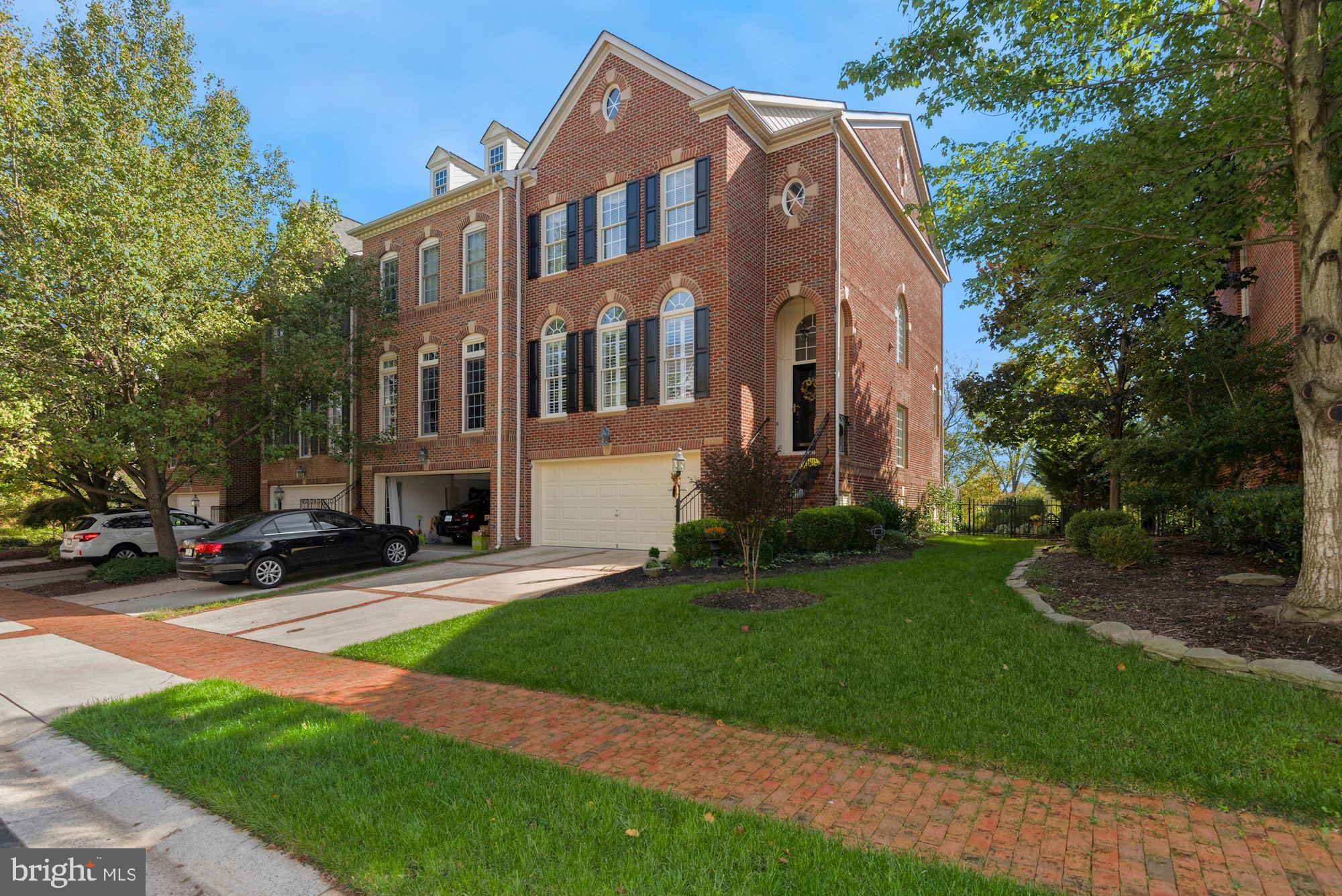 Stunning all brick end unit w/ amazing golf course & year round Goose Creek water views!  Better yet, this home features southern exposure for you to enjoy the spacious deck (with Awning), the Master Bedroom balcony, and the patio off of the walk-out lower level.   This FOUR LEVEL home has been meticulously maintained and tastefully updated, don't miss out.    Some of the highlights include gleaming hardwood floors on the main level,  new quartz countertops and an expanded kitchen island and French doors leading to composite deck w/ wrought iron railing.  Great floorplan w/ Family/ Sitting Room off of the kitchen, along with large Dining and Living Room areas featuring extensive crown moulding, chair rail, etc.   Finished 4th level is large enough to be an additional Guest Room AND an ideal home office with stunning golf & water views.  The lower level recreation room boasts upgraded tile flooring, built in shelves flanking the Gas FP and an upgraded bathroom.  Even the stairs have been tastefully upgraded, with white wood stairs and carpet runners.   Many other details and upgrades, truly TURN KEY property.   Professional Photos on Wed 10/14, Showings can be scheduled starting Thursday 10/15.   Please see Drone tour under tours!