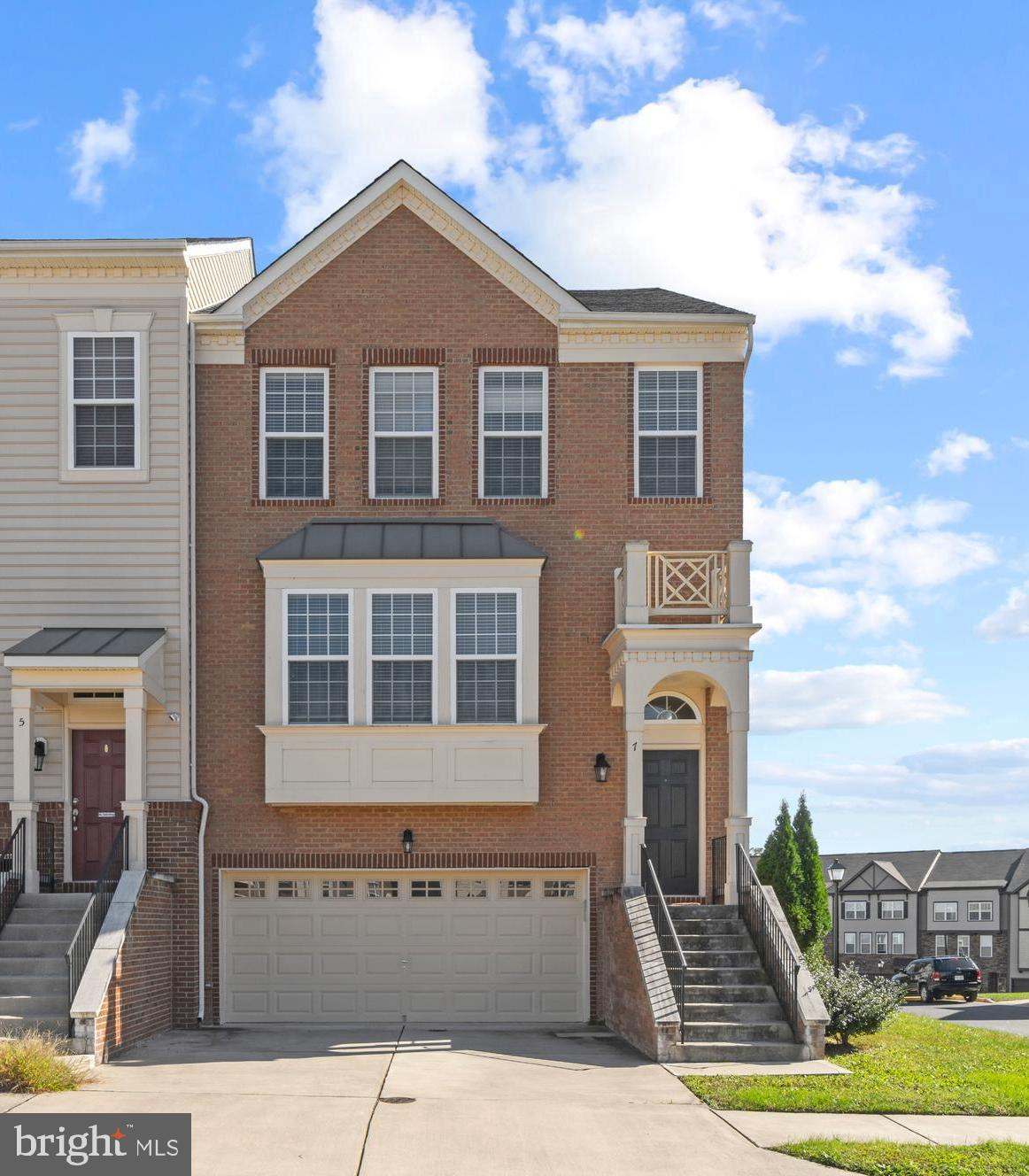 Luxury End Unit Townhouse ready for QUICK Closing!  All Three Bedrooms on Upper Level have Cathedral