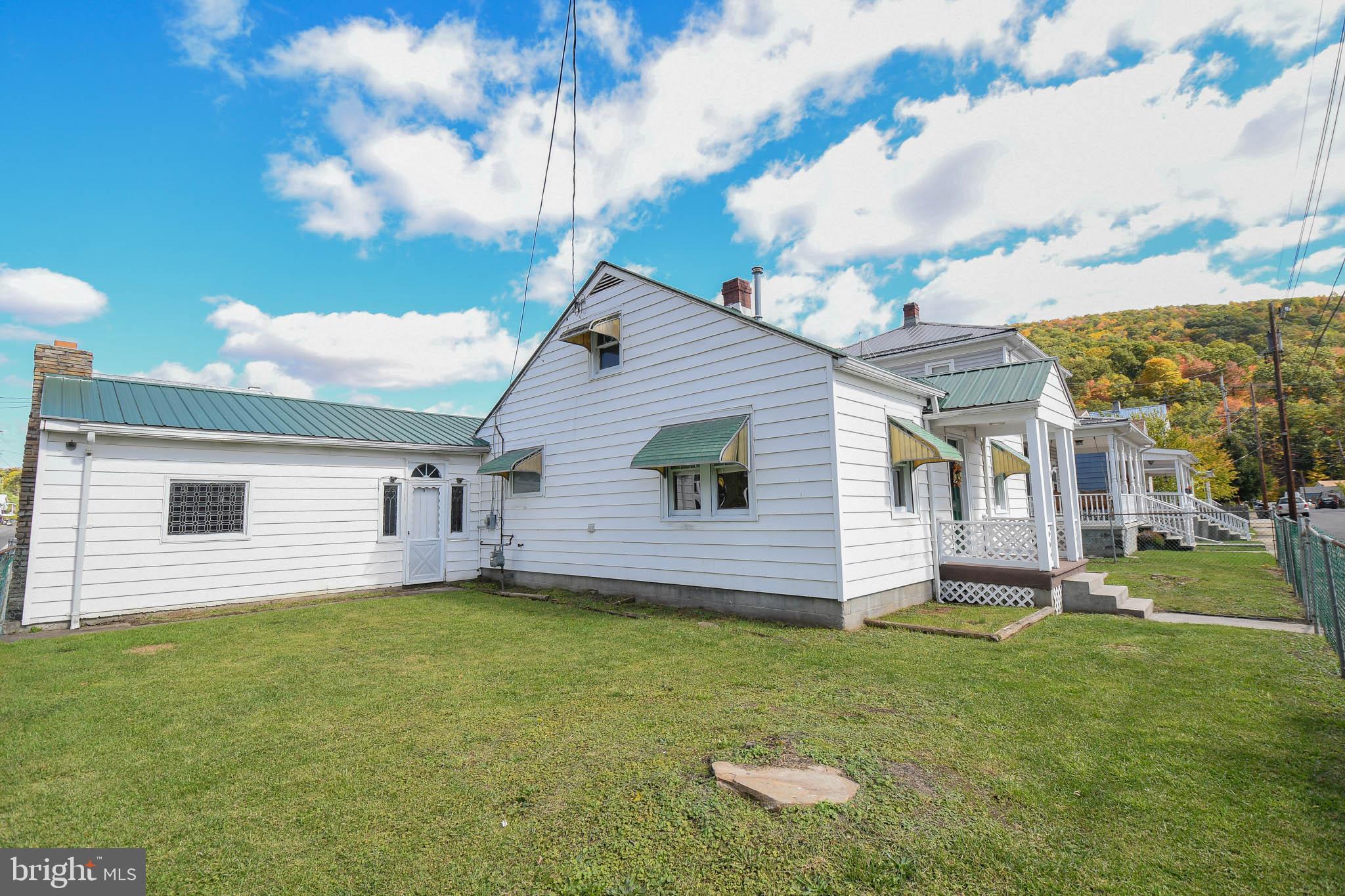 1800+ sq.ft.!  3 Bed 2 Full Bath bungalow in the heart of Keyser.  MASSIVE 28x17 sunken family room