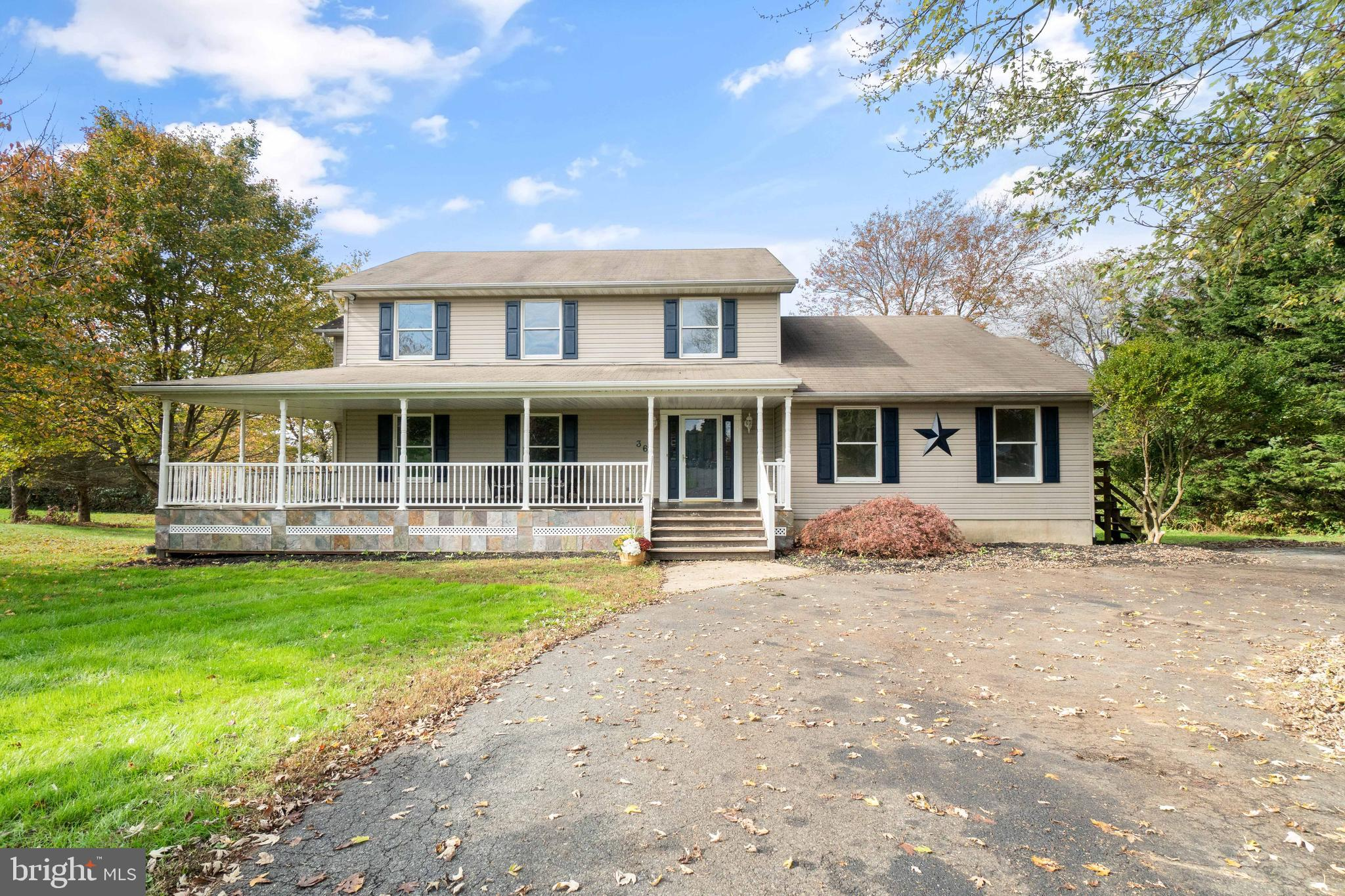 Beautiful colonial with wrap around porch on almost 2 acres in the sought after neighborhood of Fox