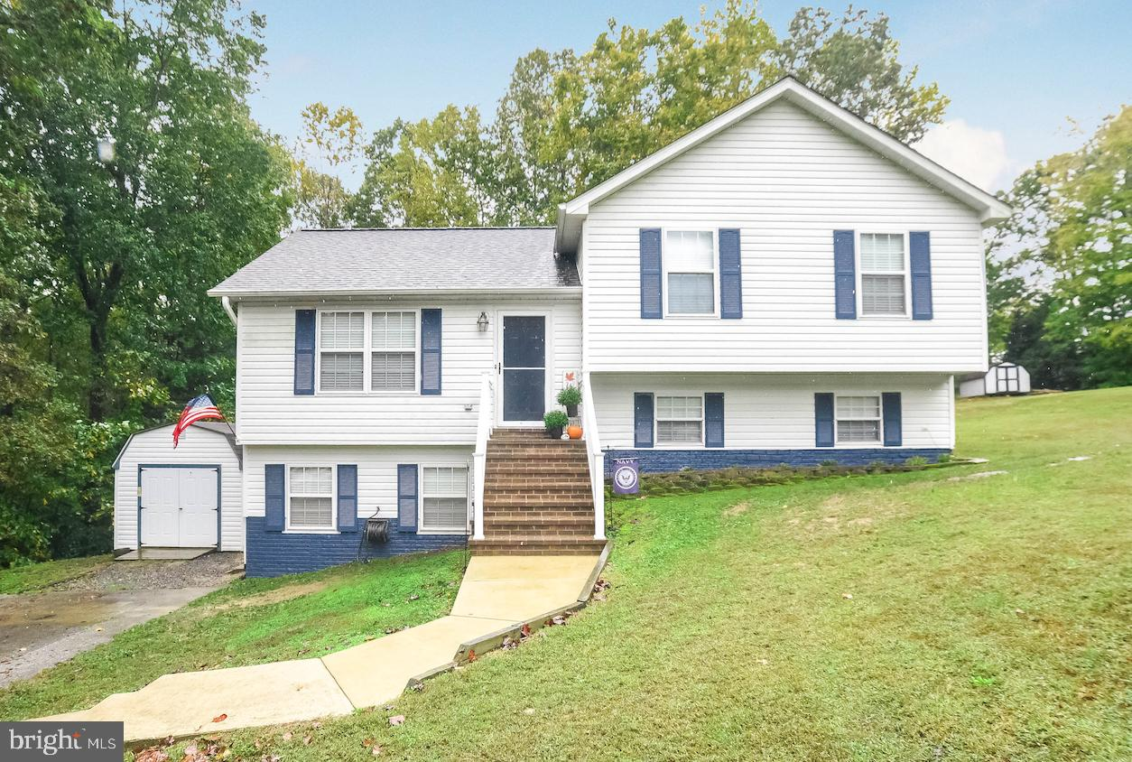 This wonderful 4-level Split seems the perfect spot to lay down roots.  This home sits on a large lo