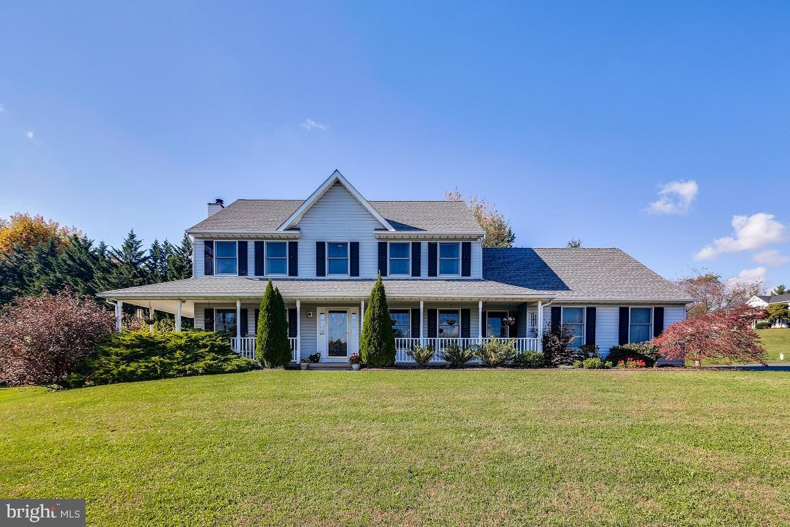 This move-in ready, 4 Bedroom 3 Full Bathroom colonial is situated on just under one acre on a corne
