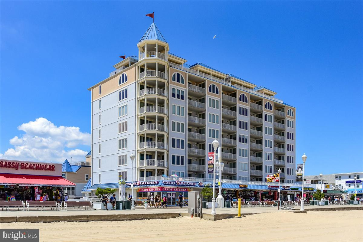 Incredible rental history! Don't miss this rare opportunity to own in one of the most well appointed buildings in Ocean City Maryland. Belmont Towers is located directly on Ocean City's famous boardwalk. Come smell the mixture of salt air and Fisher's Popcorn from your sun- filled balcony. Beautiful corner condo with breathtaking bay and ocean views. This unit offers 3 bedroom 2.5 baths which has been meticulously well maintained and complete with many upgrades to include gourmet kitchen, wet bar, stainless steel appliances, crown molding in every room and wainscoting. Balcony access from all bedrooms with views of the bay and ocean. Two assigned parking spots in a secured covered garage, elevator, fitness center, sauna, putting green, rooftop pool, a sundeck with incredible views of Assateague and Ocean City pier. Belmont Towers is steps away from many famous attractions; Atlantic Ocean, beach,  boardwalk, Thrasher's fries, Candy Kitchen, pier rides and endless amusements for everyone in the family. Keep this beauty for yourself or take advantage of the easy rental income that this popular building generates. Come take a tour today!